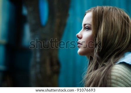 portrait of a beautiful girl on the street. Photos in cold tones - stock photo