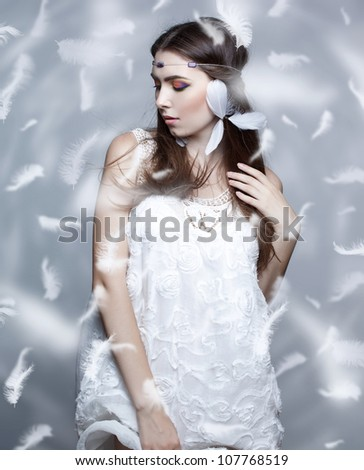 Portrait of a beautiful girl on white background - stock photo
