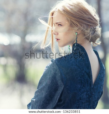 portrait of a beautiful girl outdoors - stock photo