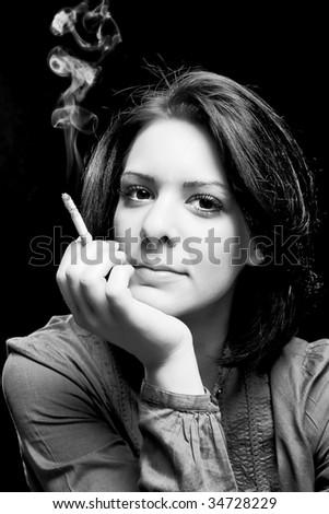 portrait of a beautiful girl smoking a cigar - stock photo