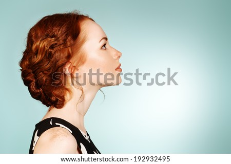 Portrait of a beautiful girl standing in profile. Beauty, fashion, hairstyle. - stock photo