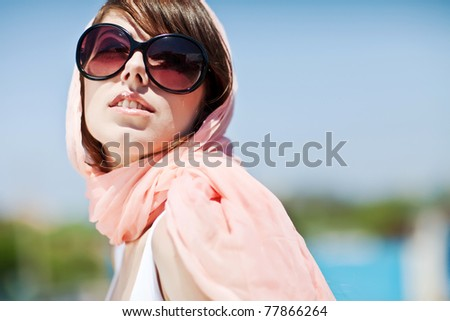 Portrait of a beautiful girl. Summer holiday, sunglasses, hat. - stock photo