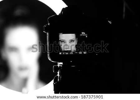 Portrait of a beautiful girl through lens - stock photo