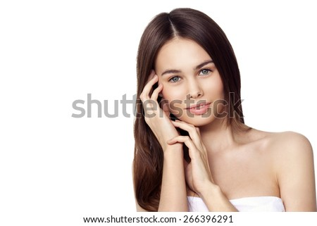 Portrait of a beautiful girl touching her face - stock photo