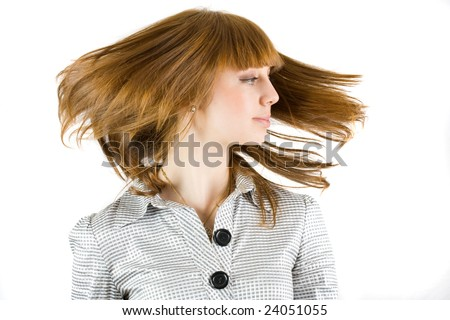 Portrait of a beautiful girl waving her hair, isolated