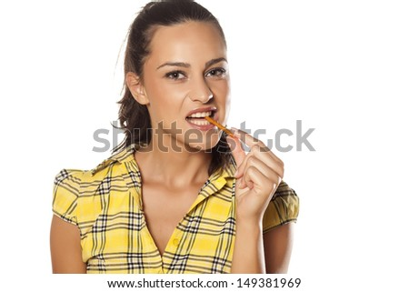 portrait of a beautiful girl who greedily eats grissini - stock photo