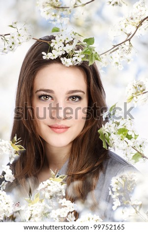 Portrait of a Beautiful Girl with a Blooming Tree - stock photo