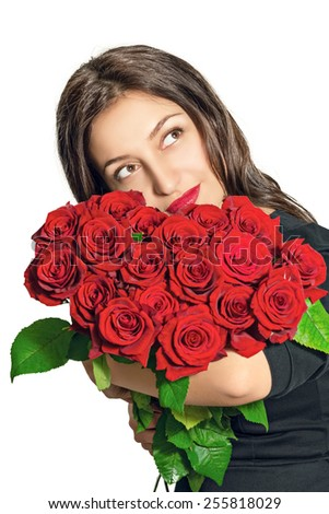Portrait of a beautiful girl with a bouquet of roses - stock photo