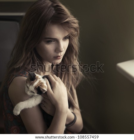 portrait of a beautiful girl with a cat
