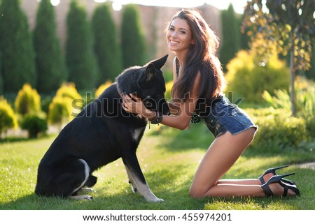 portrait of a beautiful girl with a dog