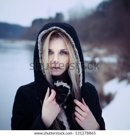 portrait of a beautiful girl with a magical person - stock photo