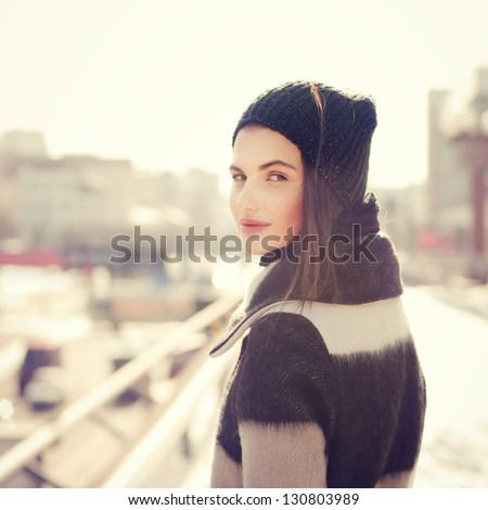 portrait of a beautiful girl with a Spanish appearance in winter - stock photo