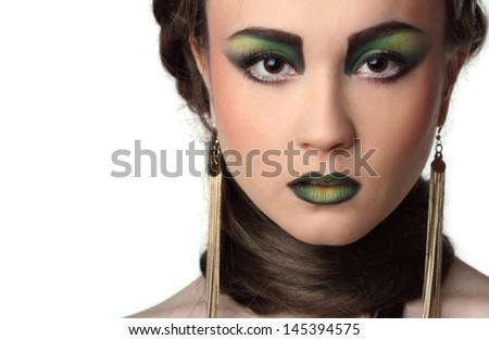 portrait of a beautiful girl with art make-up - stock photo