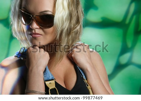 portrait of a beautiful girl with big glasses - stock photo