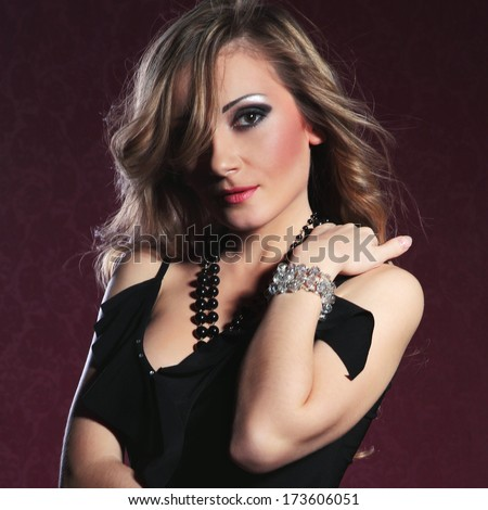Portrait of a beautiful girl with black dress fashion glamor makeup and hairstyle