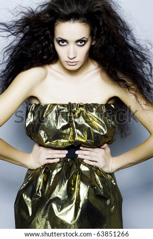 Portrait of a beautiful girl with black hair and bright make-up - stock photo