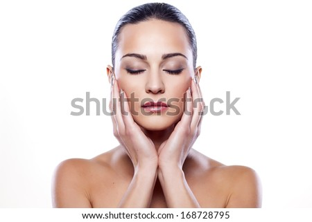 portrait of a beautiful girl with closed eyes on white background - stock photo