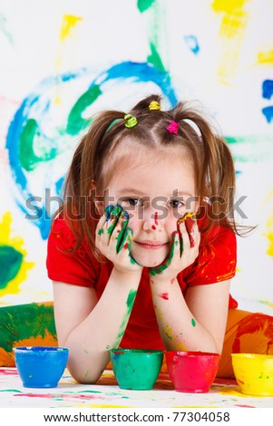 Portrait of a beautiful girl with face and hands painted - stock photo