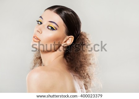 Portrait of a beautiful girl with fashion Makeup - stock photo