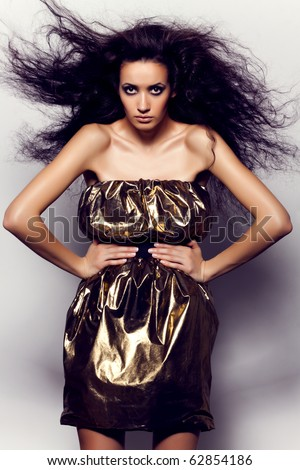 Portrait of a beautiful girl with flying black hair - stock photo