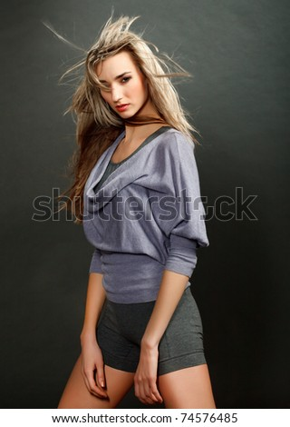 Portrait of a beautiful girl with flying blond hair - stock photo