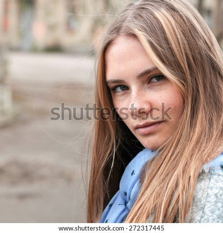 portrait of a beautiful girl with freckles, close-up  - stock photo