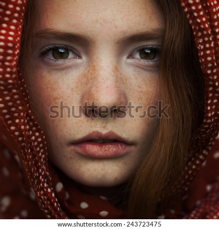 portrait of a beautiful girl with freckles. closeup photo - stock photo