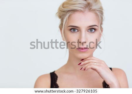 Portrait of a beautiful girl with fresh skin looking at camera isolated on a white background - stock photo