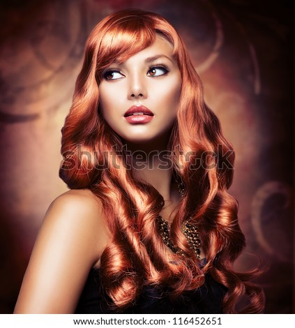 Portrait of a Beautiful Girl With Healthy Long Red Hair and Holiday Makeup. Wavy Hair.Hairstyle. Make-up. Hairdressing. - stock photo