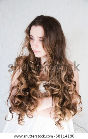 portrait of a beautiful girl with long curls