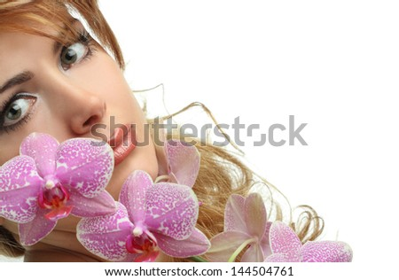 portrait of a beautiful girl with orchids - stock photo