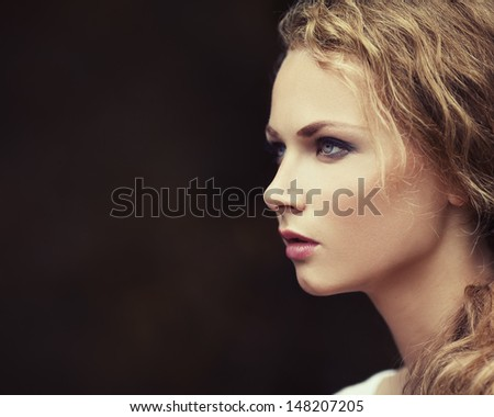 Portrait of a beautiful girl with perfect skin in a profile - stock photo