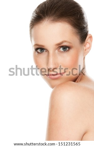 Portrait of a beautiful girl with tender skin over a white background