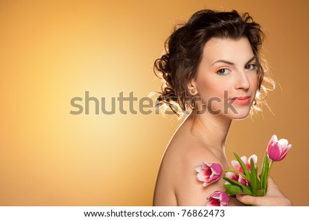 Portrait of a beautiful girl with tulips - stock photo