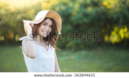 Portrait of a beautiful girl with white dress in the garden - stock photo