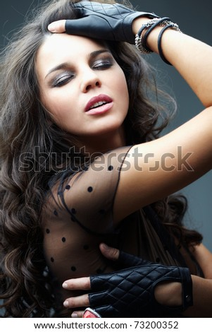 Portrait of a beautiful glamorous brunette - stock photo