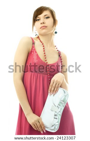 portrait of a beautiful glamorous lady with a silver clutch - stock photo