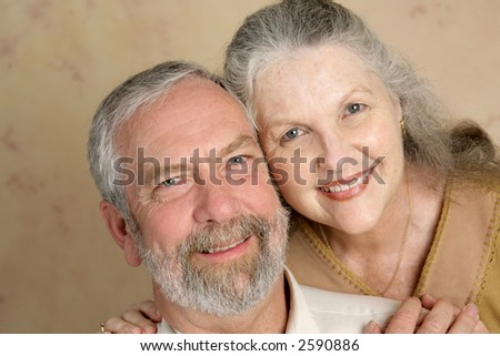 Portrait of a  beautiful gray haired middle aged couple in love. - stock photo
