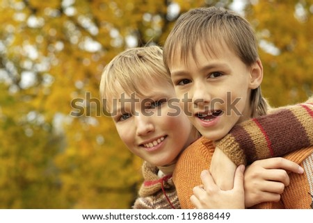 portrait of a beautiful happy boys relaxing in autumn
