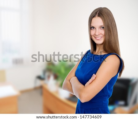 Portrait of a beautiful happy business woman in a blue dress - stock photo