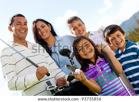 Portrait of a beautiful happy family playing golf - stock photo