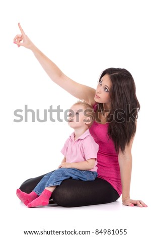 Portrait of a beautiful happy mother point finger to the up corner with child 2 years boy isolated on white - stock photo