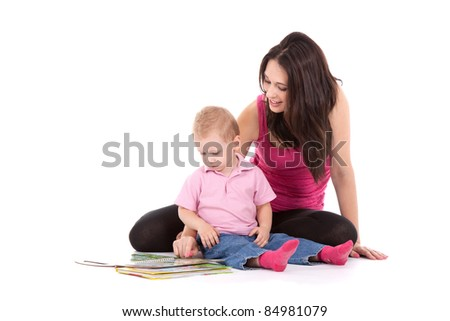 Portrait of a beautiful happy mother with child 2 years boy read book isolated on white - stock photo