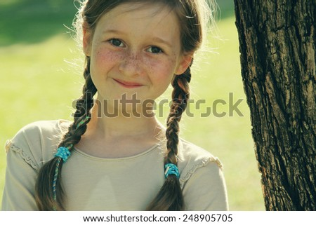portrait of a beautiful happy smiling girl outdoors - stock photo