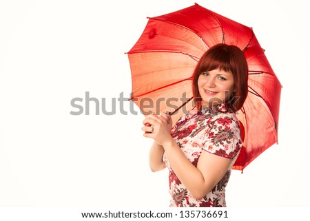 Portrait of a beautiful happy smiling girl with red umbrella isolated on white - stock photo