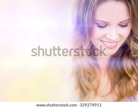 Portrait of a beautiful happy woman smiling  - stock photo
