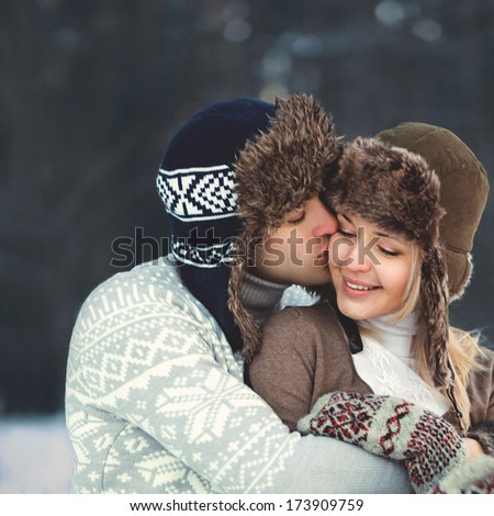 Portrait of a beautiful happy young couple in love in warm winter day, tenderness lifestyle moment - stock photo
