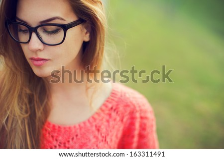 portrait of a beautiful hipster girl in glasses close up - stock photo