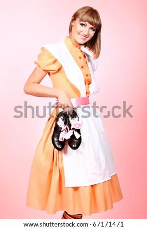 Portrait of a beautiful housewife. Studio shot. - stock photo