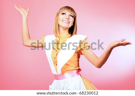 Portrait of a beautiful housewife. Studio shot. - stock photo